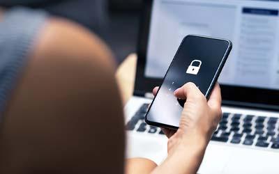 person logging into phone