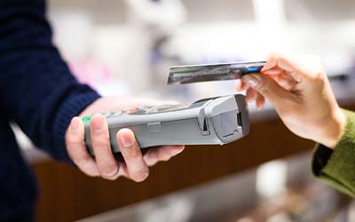 Person using contactless debit card