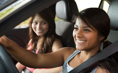 Teenagers driving in car