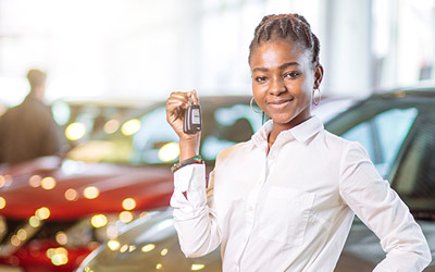 Young woman holding keys to car