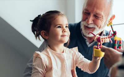 Retired man playing with granddaughter