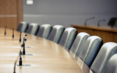 Empty chairs in a board room