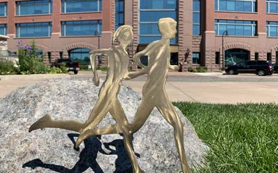 Runners art in front of the corporate center