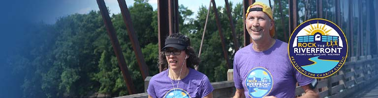 Man and wife running at Rock the Riverfront