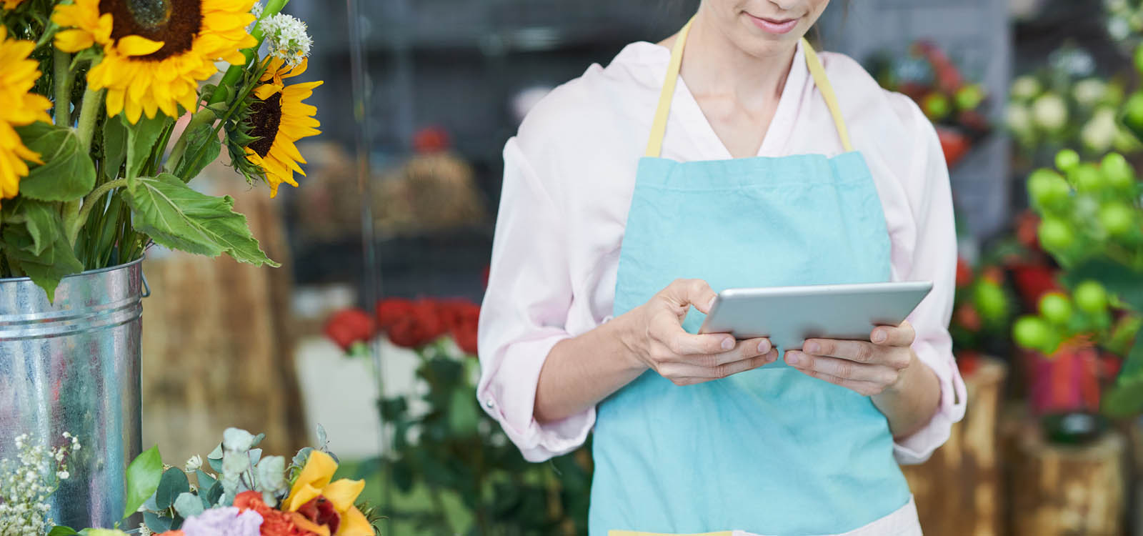 woman in flower shop on tablet