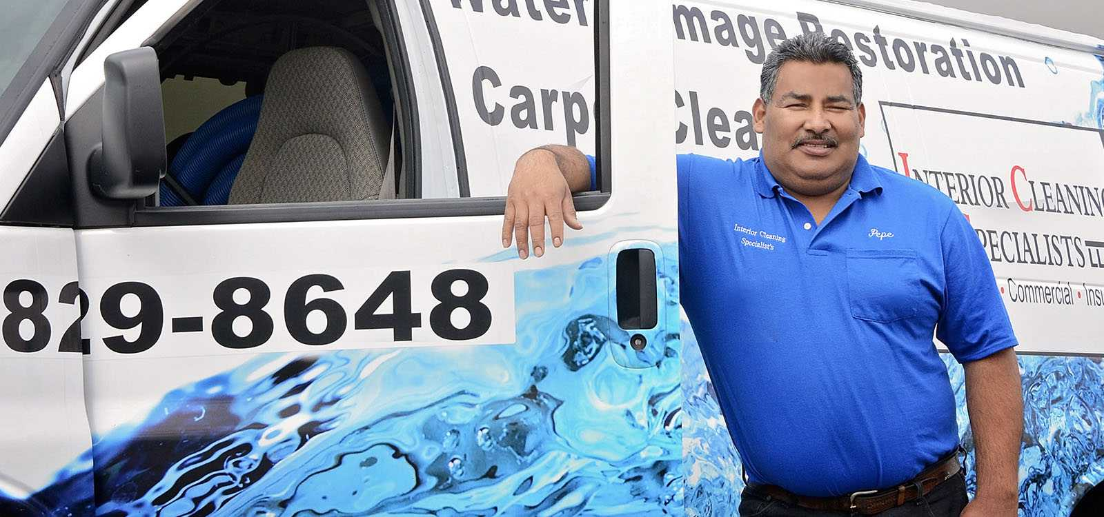 man leaning against business van