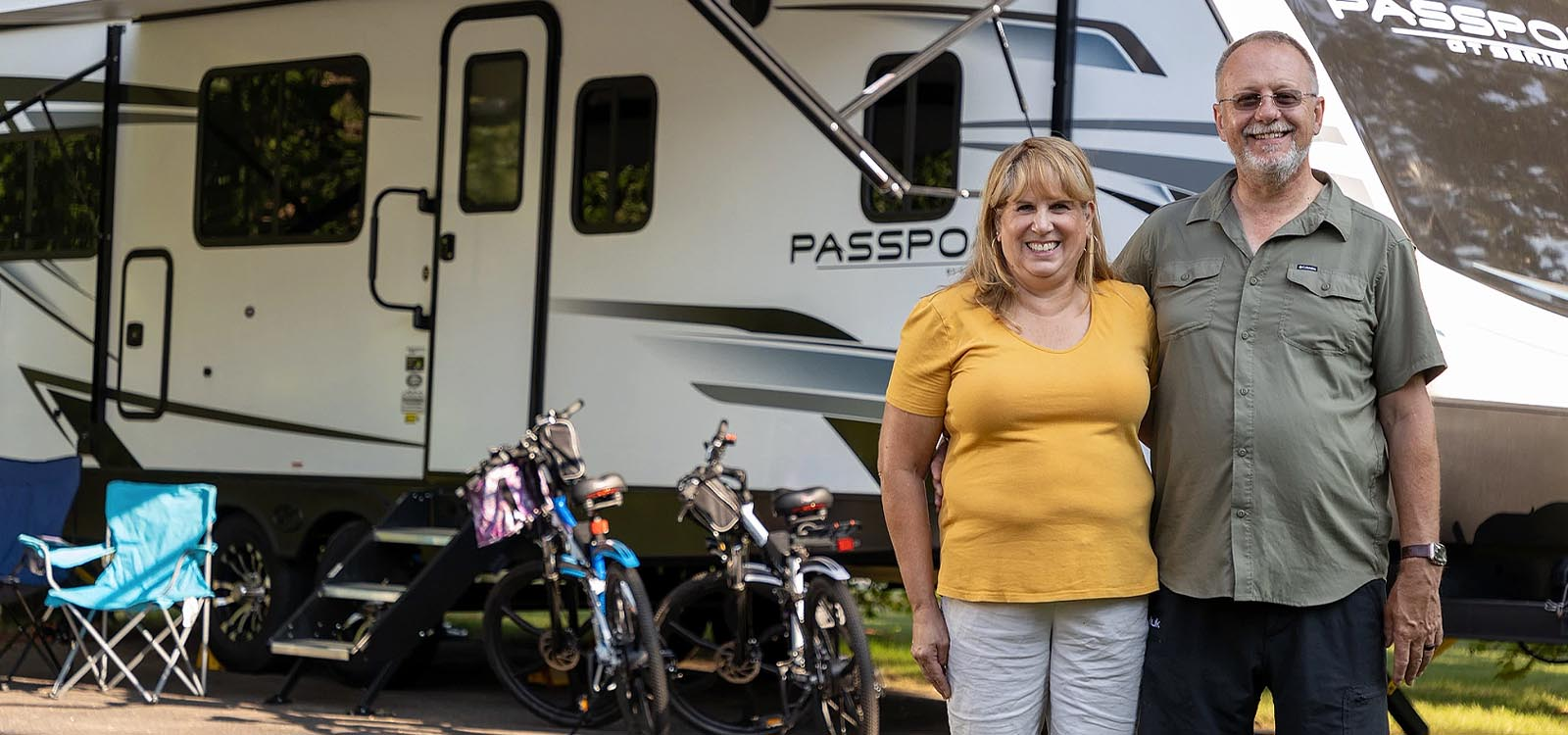 Couple in front of their RV