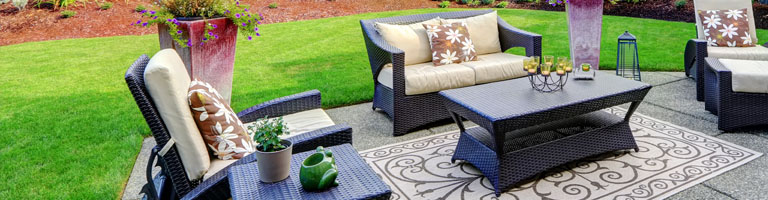 outdoor loveseat, chairs, and table on patio
