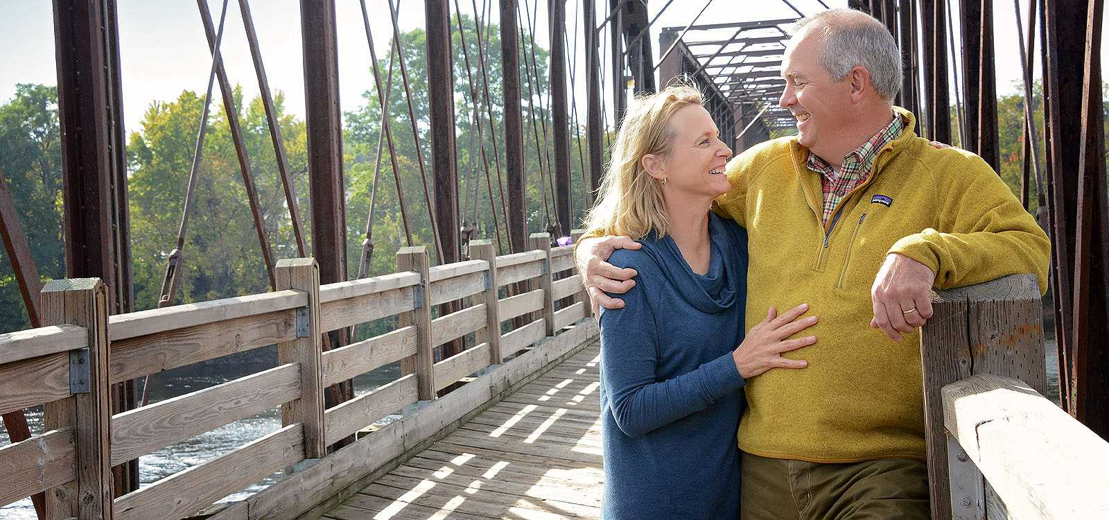 older man and woman on a bridge