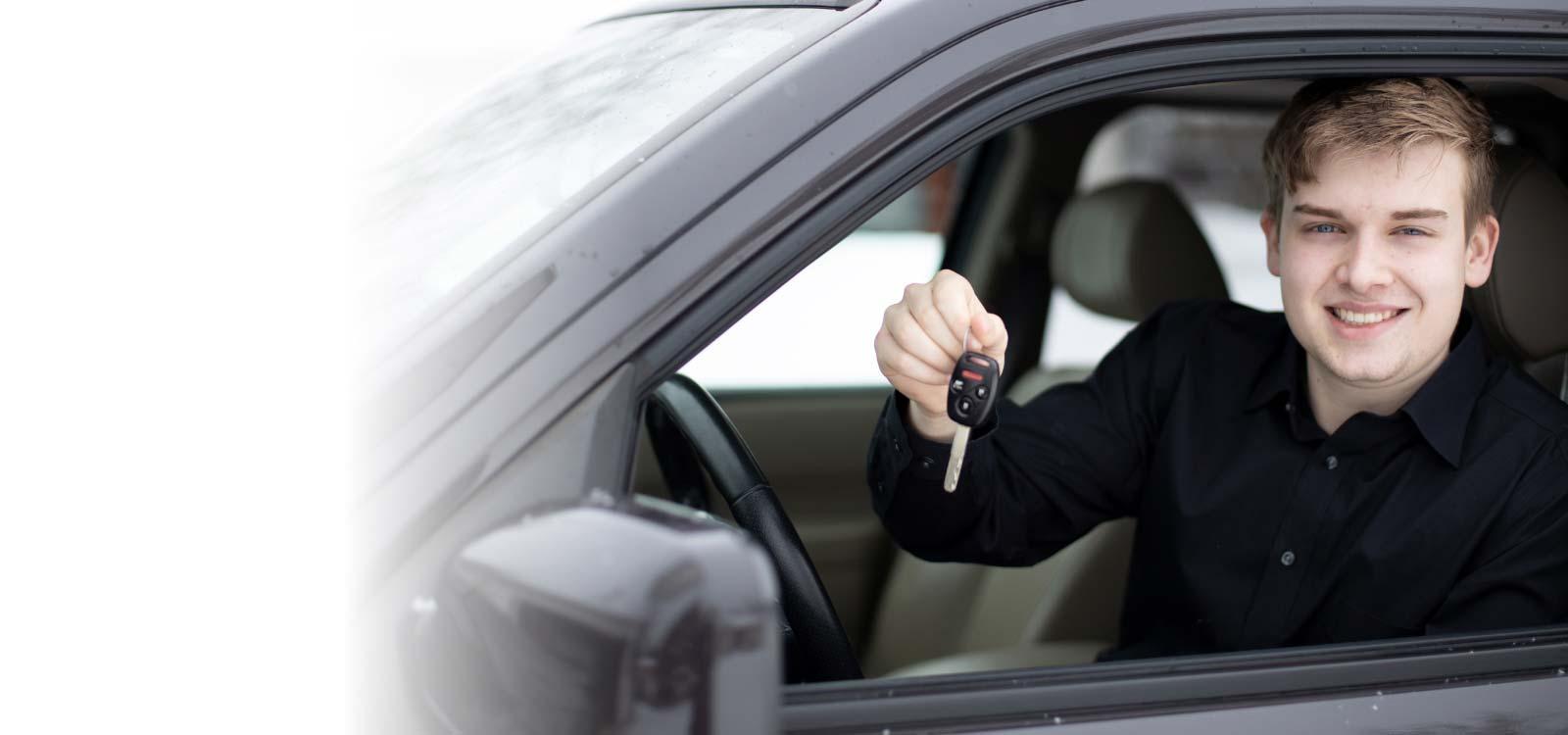 Man holding keys of new car