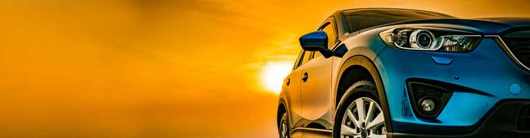 new car at sunset